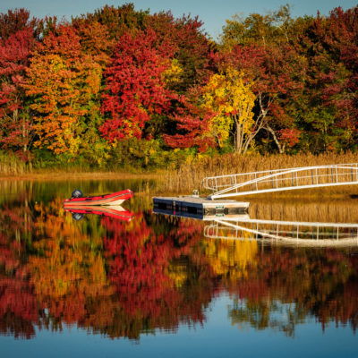 Dinghy on lake with fall foliage near Kennebunkport, Maine